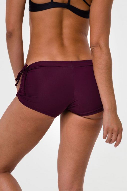 onzie_side_tie_hot_yoga_shorts_aubergine